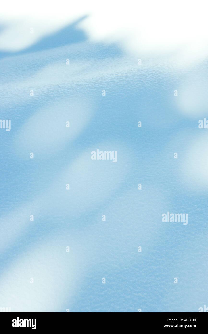 Schatten auf dem Schnee Stockbild