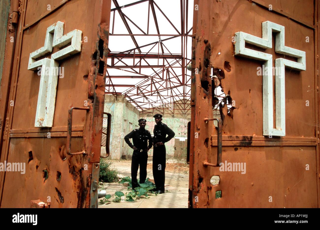 Nigeria: religiöse Konflikte zwischen Christen und Muslimen. Muslimen zerstört und brannte diese römisch Stockbild