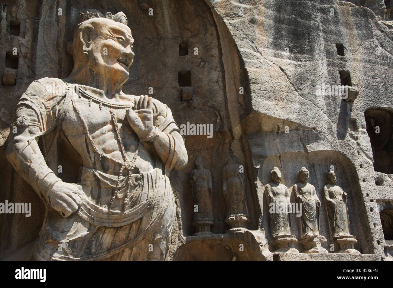 Geschnitzten Buddha-Statuen in Longmen Grotten, Dragon Gate Grotten, Provinz Henan, China Stockbild