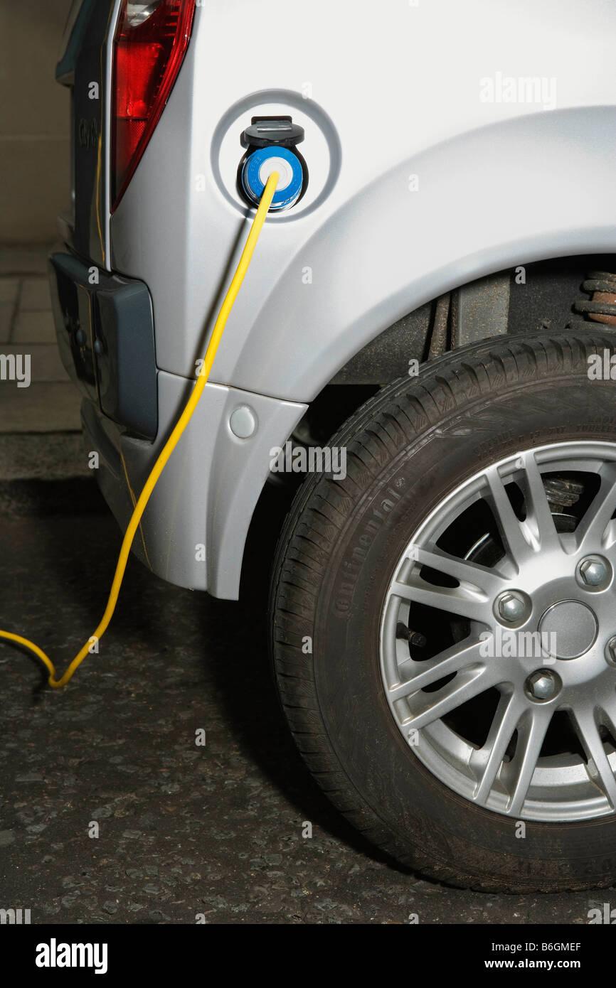 Elektrische Kabel, Elektro-Auto Stockbild