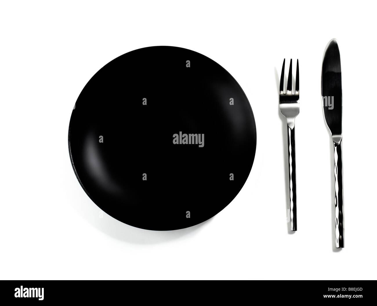 Schwarze leere Teller und Besteck Stockbild