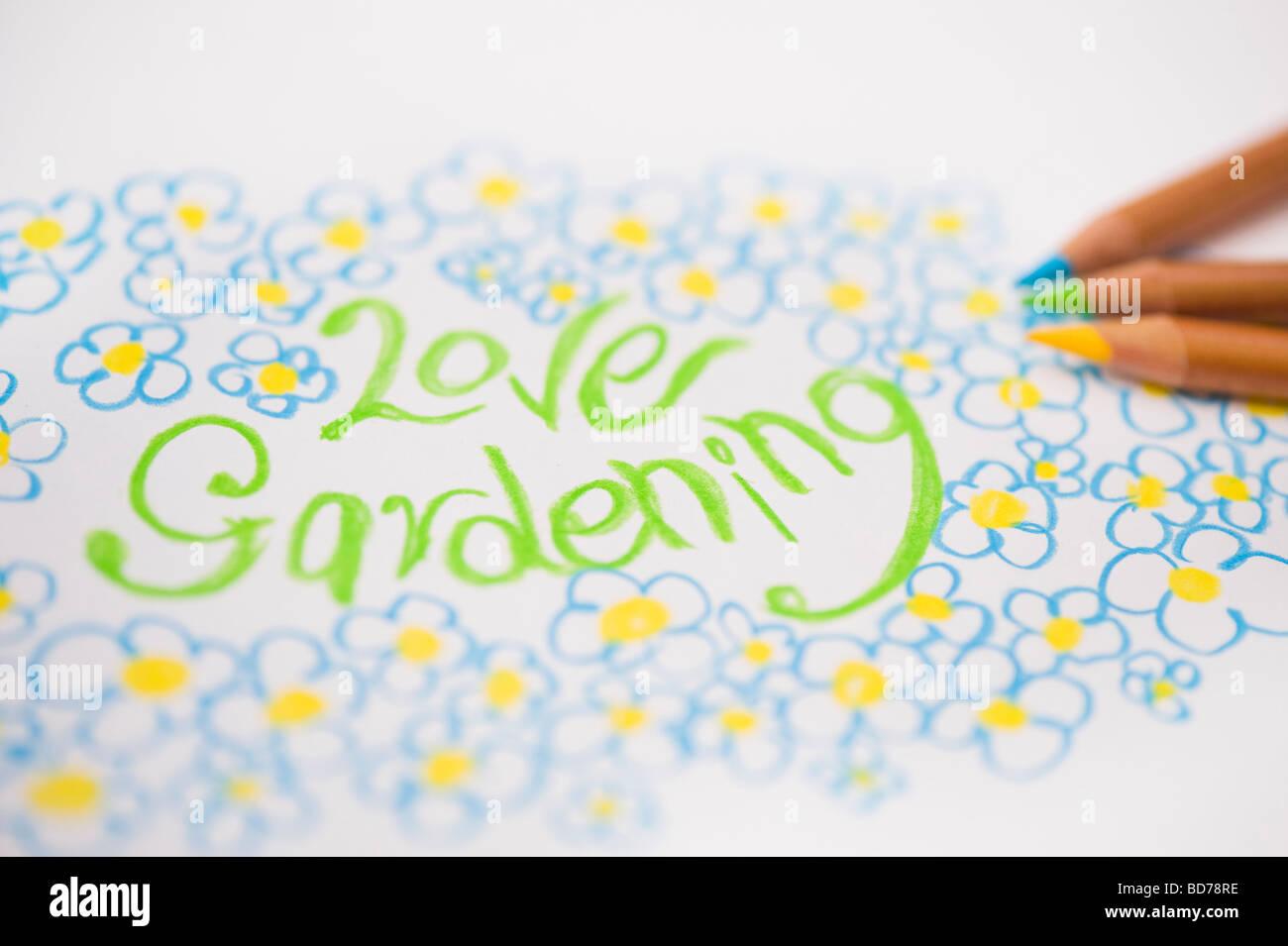 Liebe Garten- und Blumen, des Kindes Zeichnung und Buntstifte Stockbild