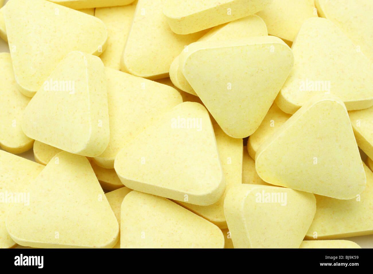Gelbe Farbe Dreiecksform Multi Vitamin Tabletten Hintergrund Stockbild