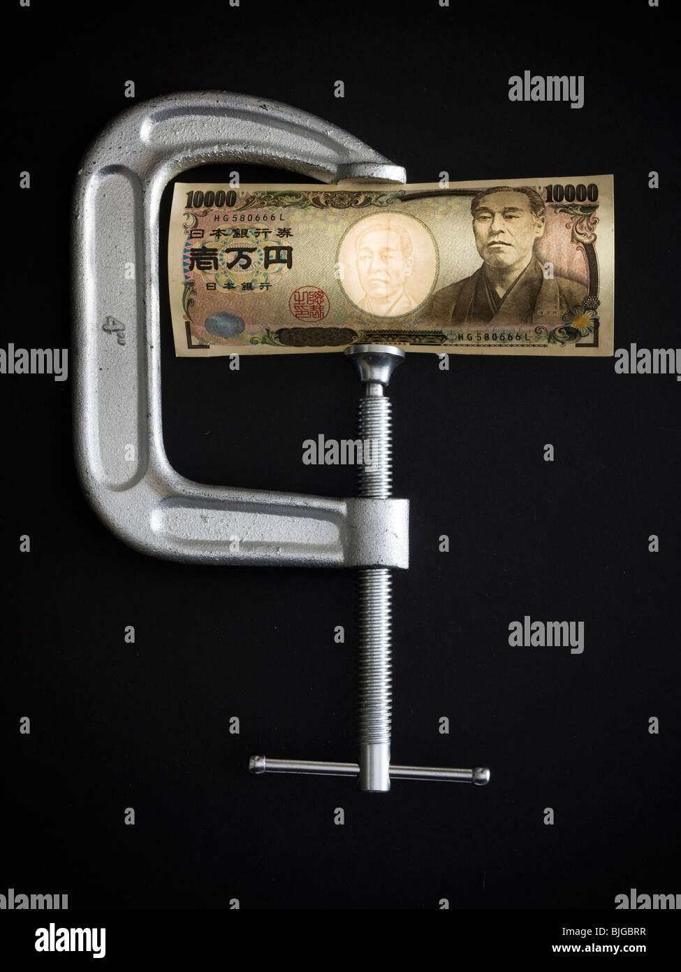 Yen in einer Klemme Stockbild