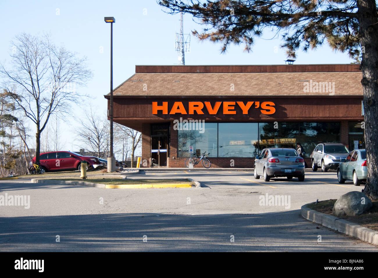"""Harvey Harveys """"Harveys"""" Fast-Food Burger Restaurant ungesunde Pommes Koks ölige Fett Mcdonald Burger Stockbild"""