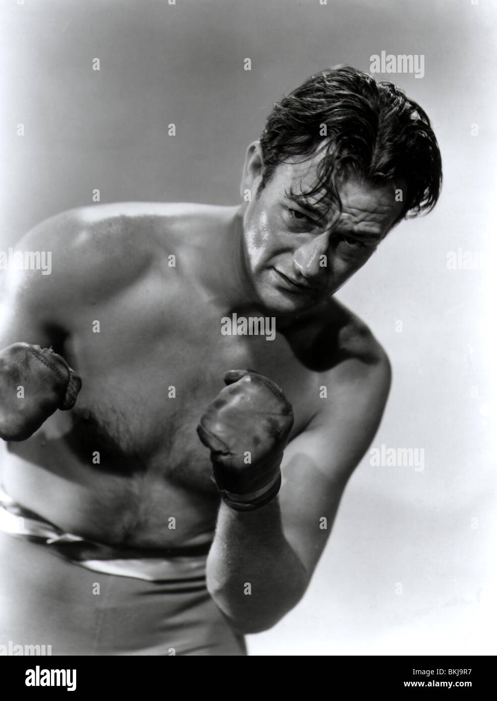 KONFLIKT-1936 JOHN WAYNE CONF Stockbild