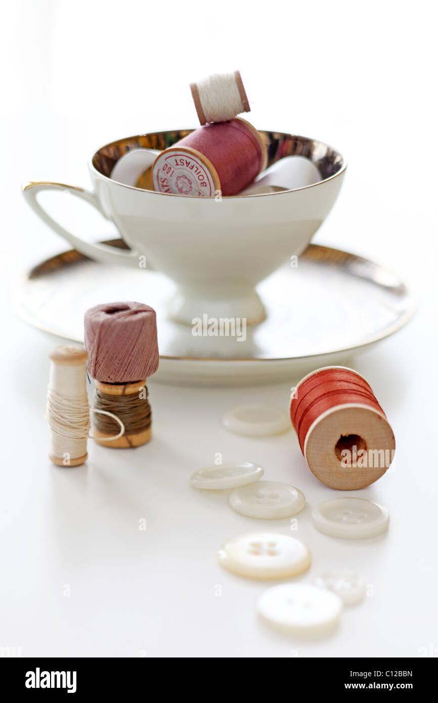 Chine Teetasse mit Spulen von Gewinden und Tasten Stockbild