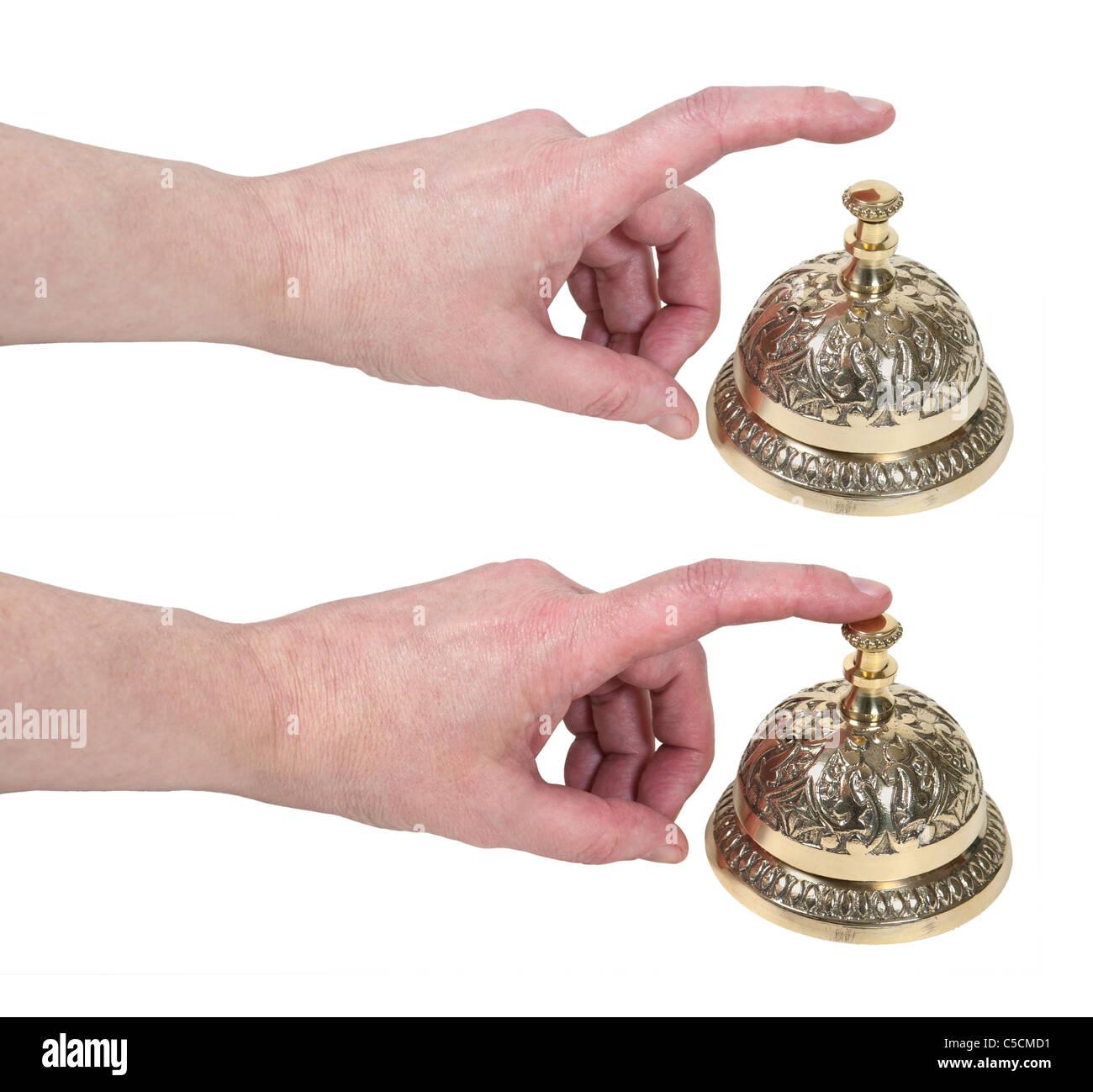 Wie man für Service gezeigt von einer Hand Tippen auf eine komplizierte Dienst Messingglocke ring platziert Stockbild