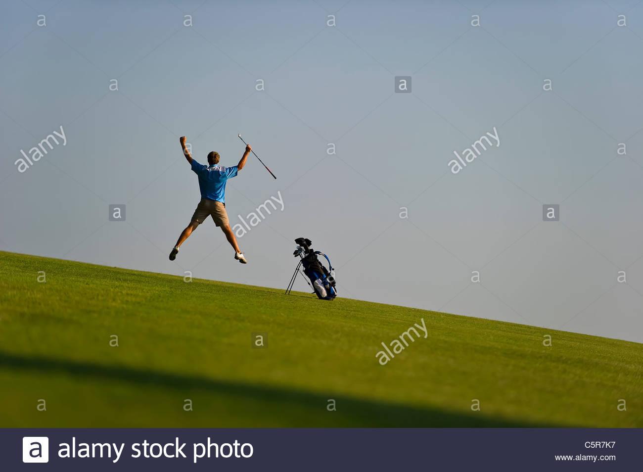 Ein Golfer feiert. Stockbild