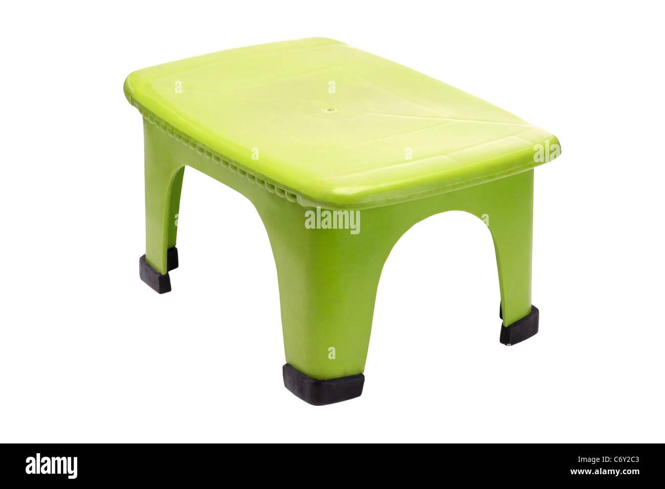 Kleine grüne Kunststoff Hocker auf weißem Hintergrund Stockbild