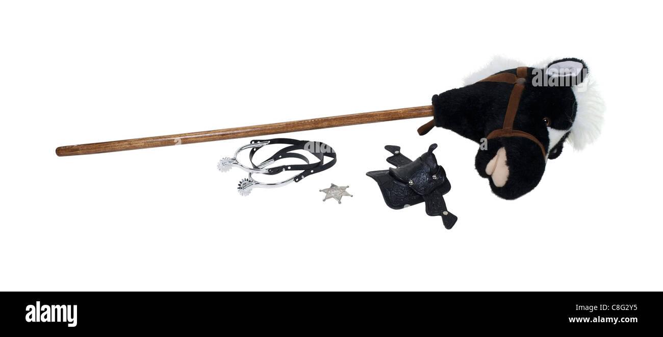 Kind-Cowboy-Set inkl. Sporen, Sheriffstern, Sattel und ein Steckenpferd - Pfad enthalten Stockbild