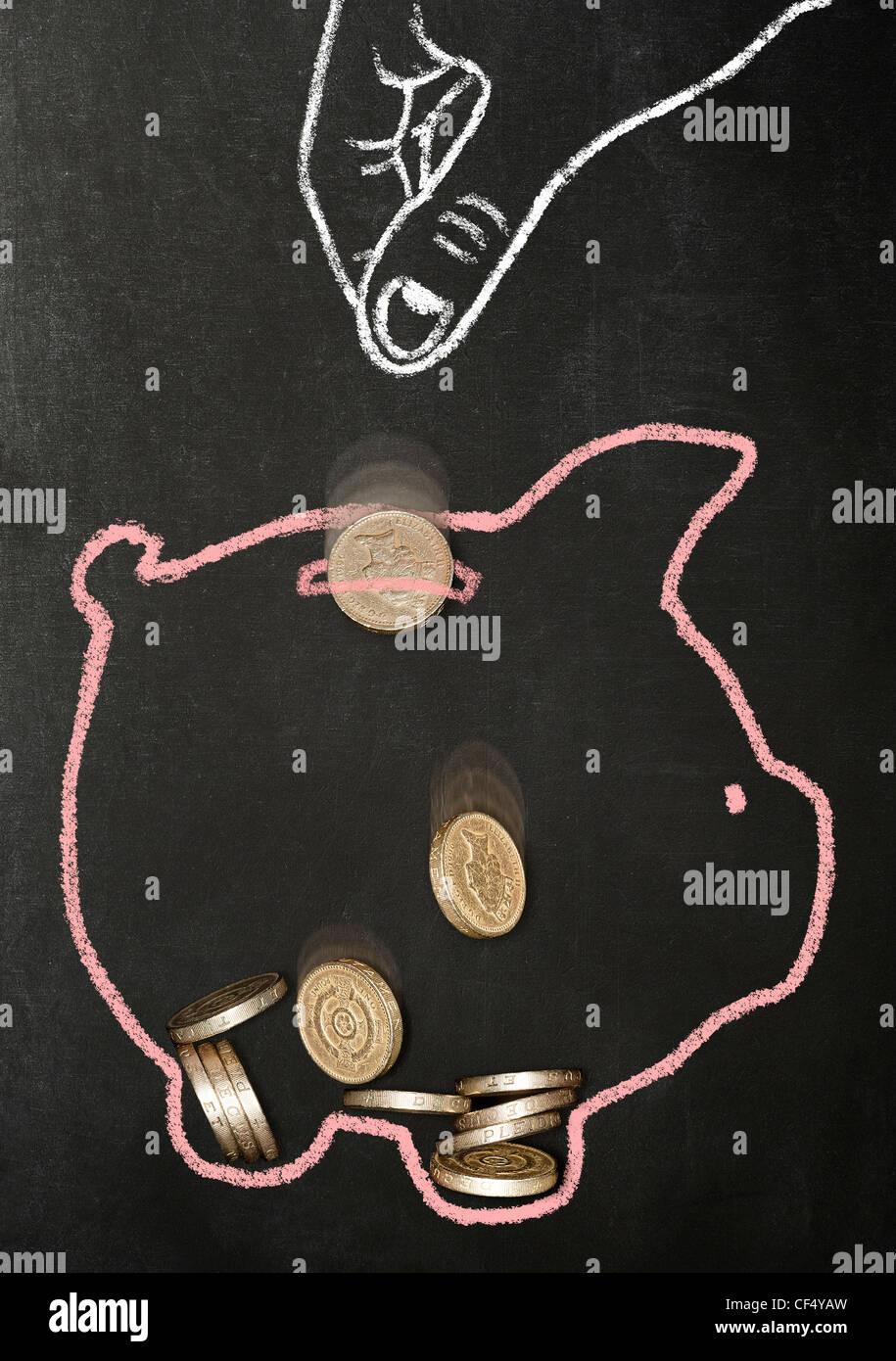 Kreide gezeichnete Hand fallenlassen echten Pfund Münzen in einem Chalk piggy Bank gezogen Stockbild