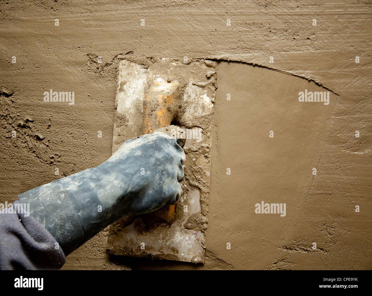 hand trowel plastering concrete wall stockfotos hand trowel plastering concrete wall bilder. Black Bedroom Furniture Sets. Home Design Ideas