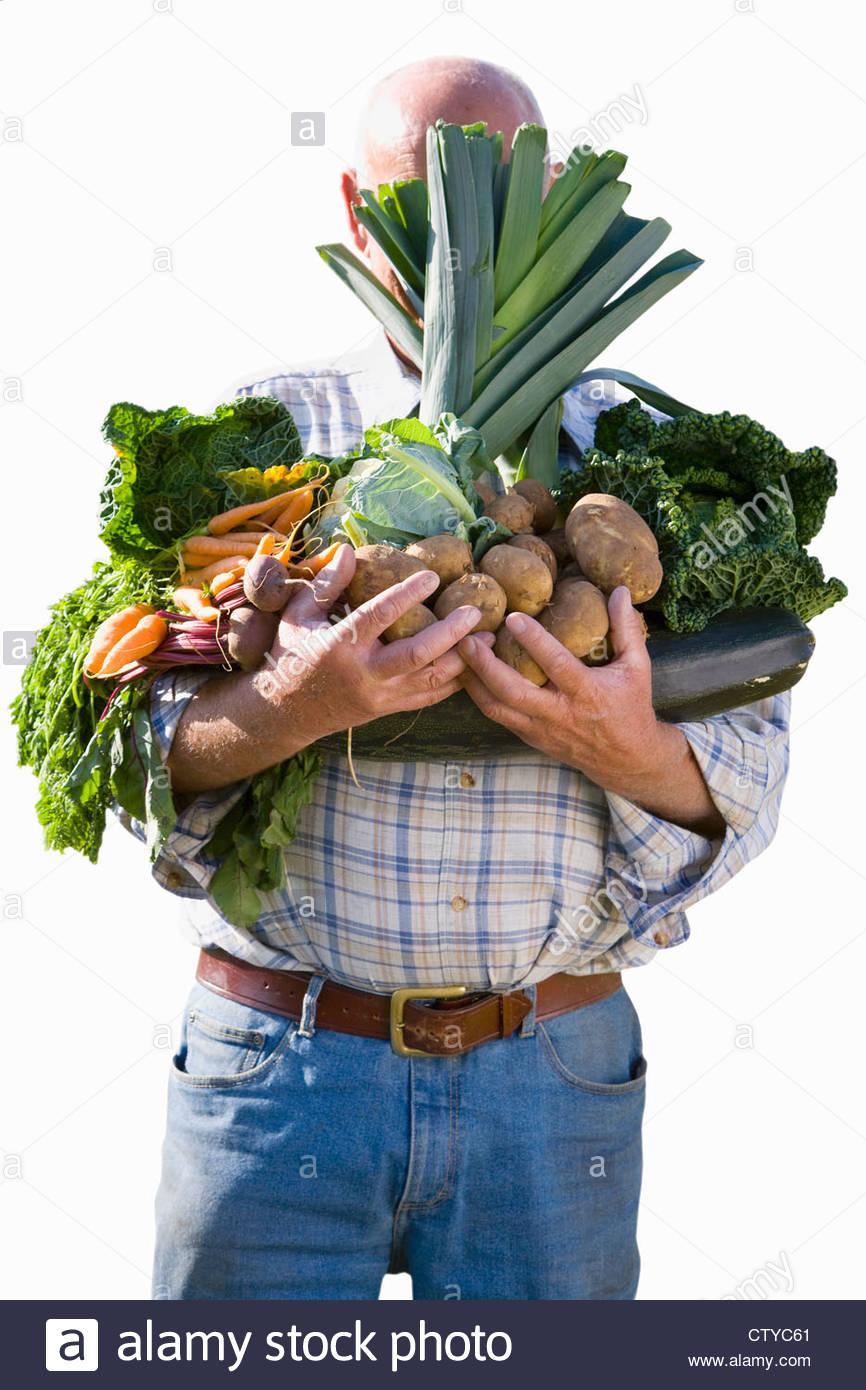 Aus Mann hinter Arm voller Gemüse Schneiden Stockbild