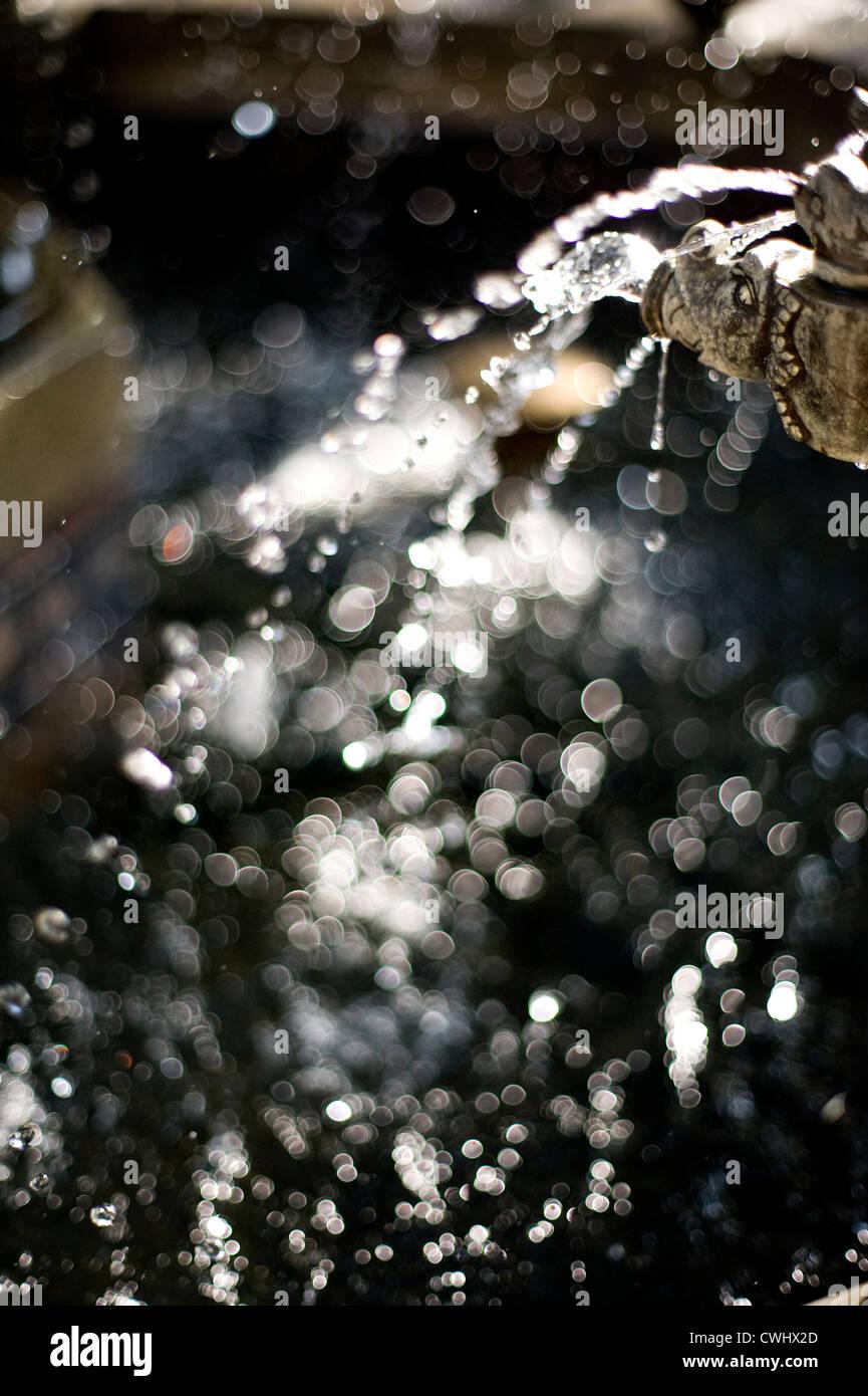 Wassertropfen, Injektion, Lichtpunkte Stockbild