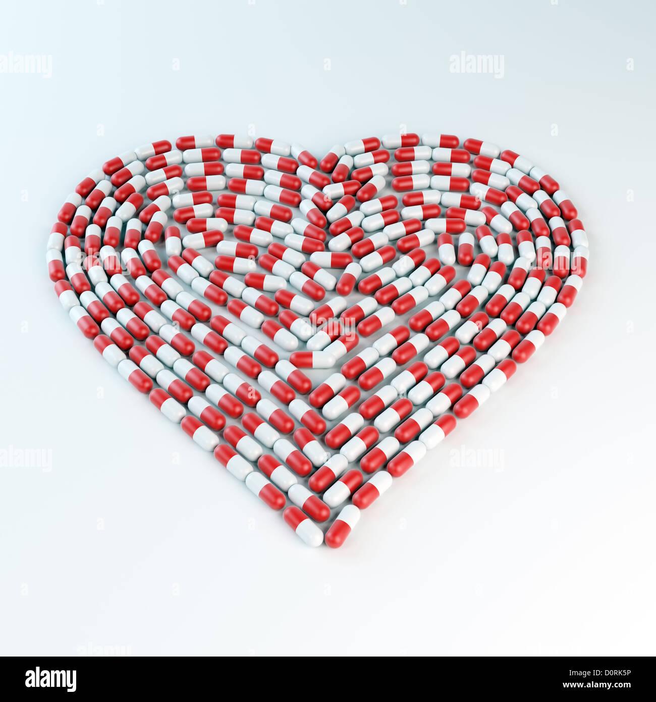 Rote und weiße Kapseln bilden ein Herz shap Stockfoto