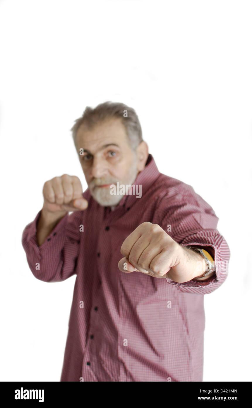 Wettbewerbsfähige Geschäftsmann in Boxen Stellung. Selektiven Fokus. Stockbild