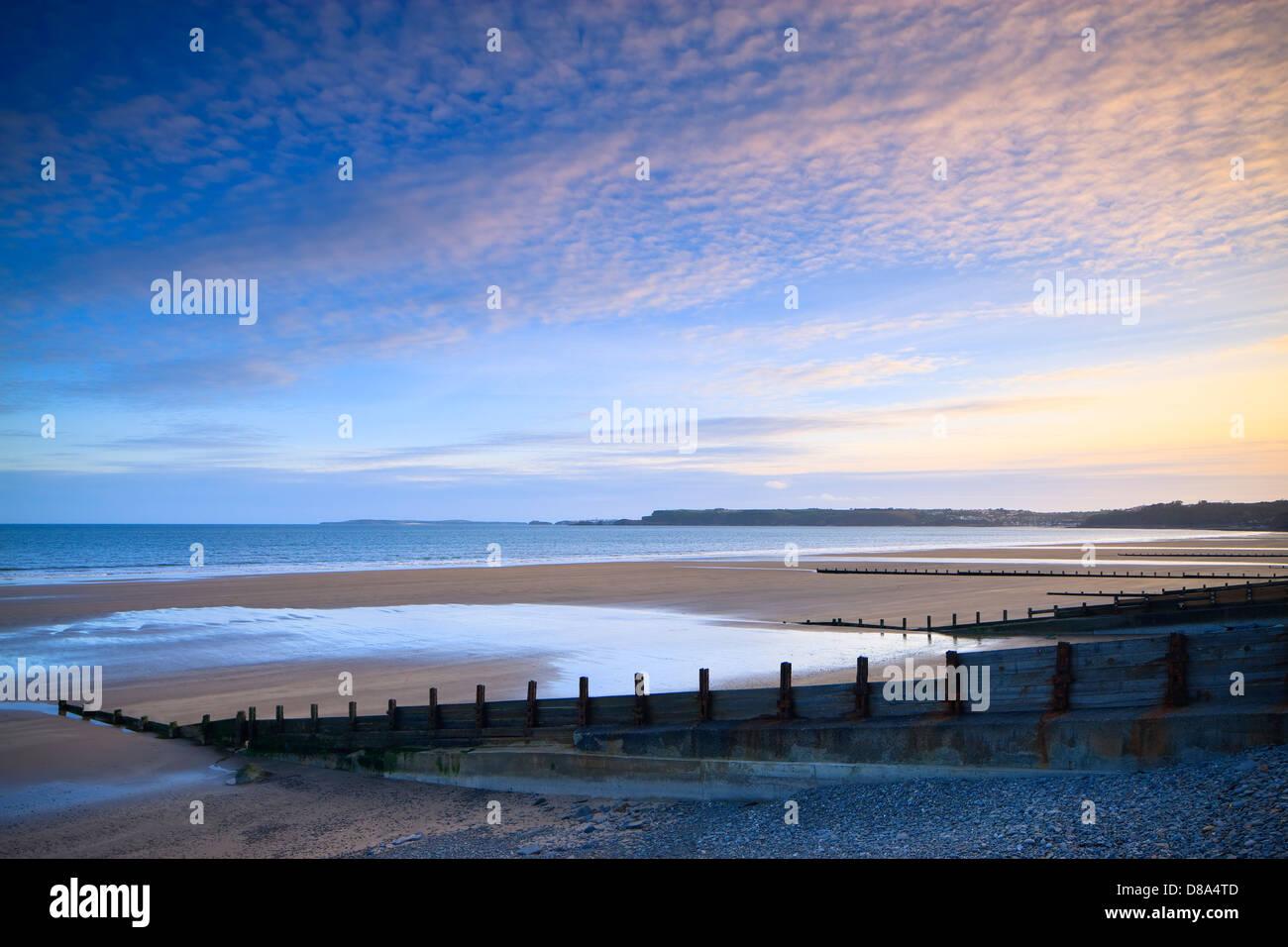 Amroth Strand nr Saundersfoot wales Pembrokeshire bei Sonnenuntergang Stockbild