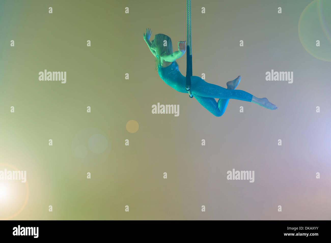 Trapezkünstler, balancieren auf Trapez Stockbild