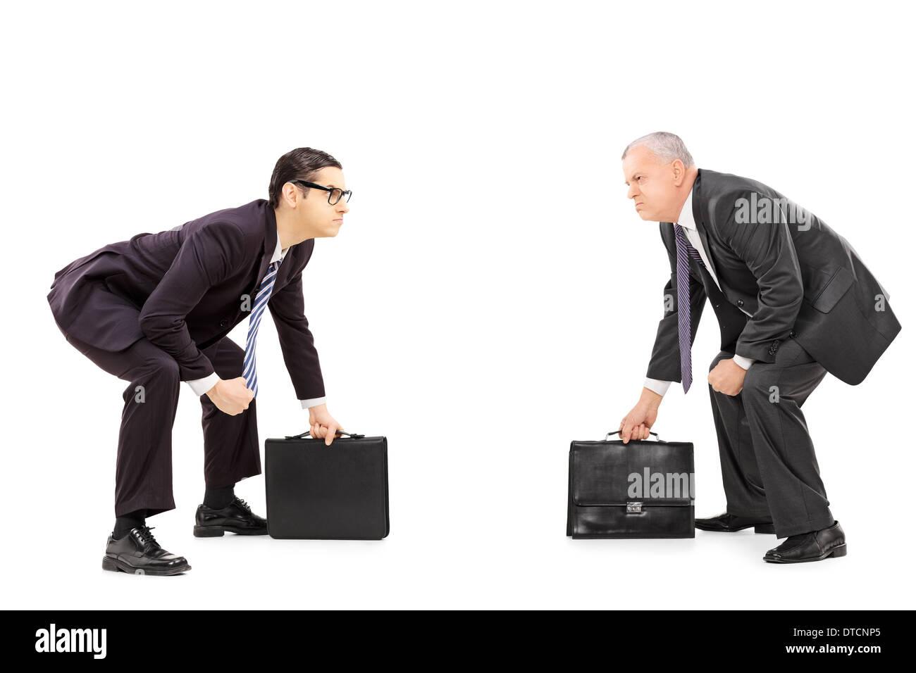 Zwei wettbewerbsfähige Geschäftsleute im Sumo-ringen Haltung stehen Stockbild