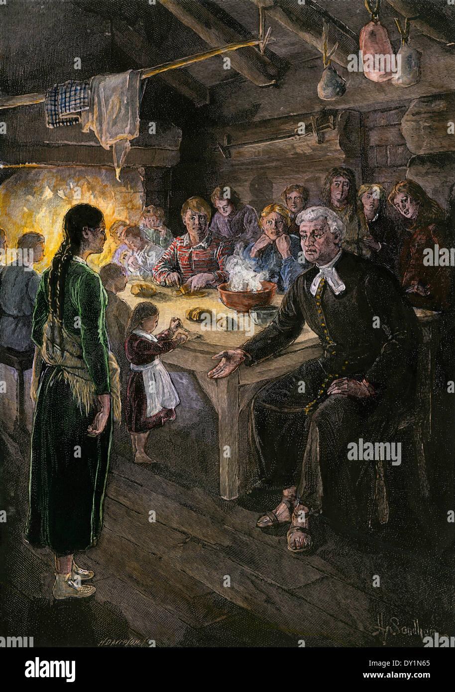 Kanadischen Siedlern versammelten sich zu einer gemeinsamen Mahlzeit, 1800 s. Stockbild