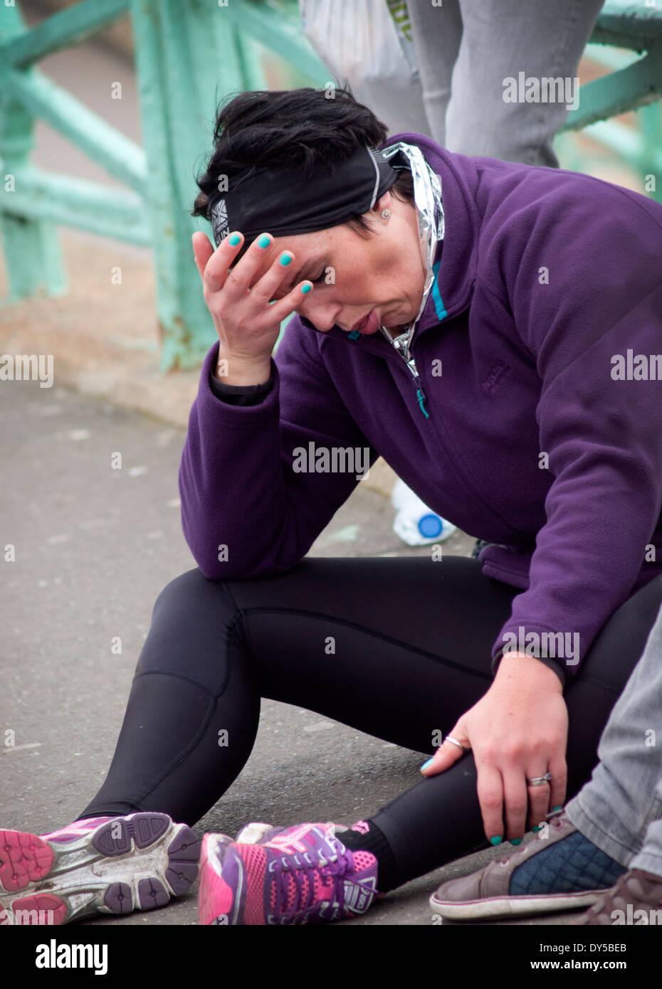 Erschöpfung am Ende des Brighton Marathon Stockbild