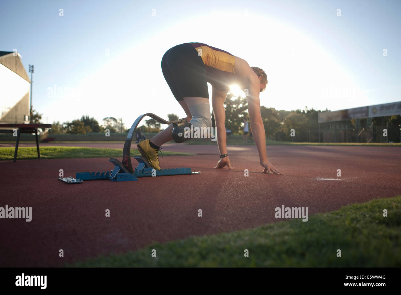 Sprinter in Startposition Stockbild