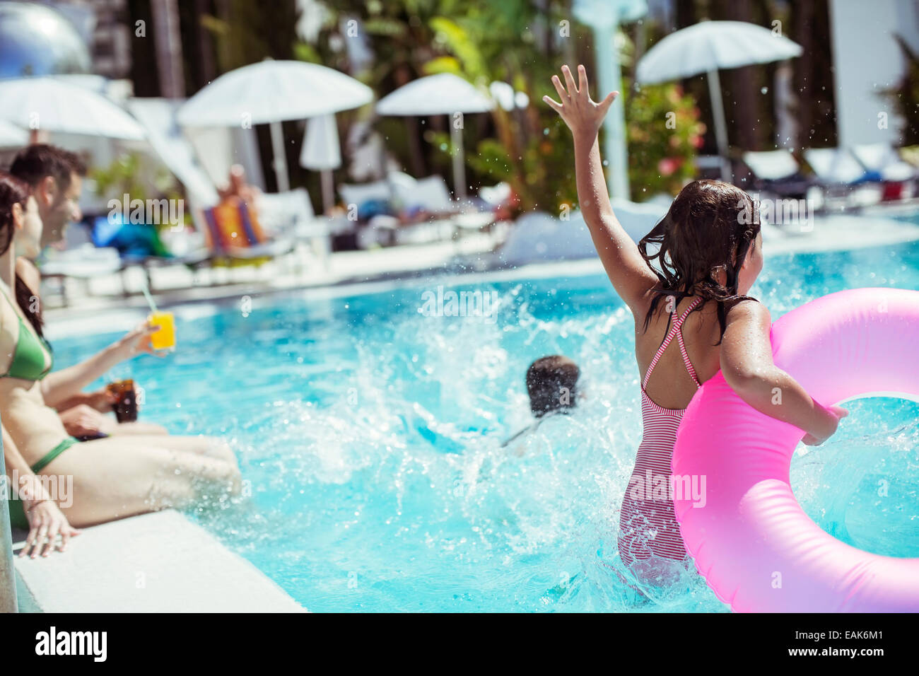 girl jumping into pool in summer stockfotos girl jumping into pool in summer bilder alamy. Black Bedroom Furniture Sets. Home Design Ideas