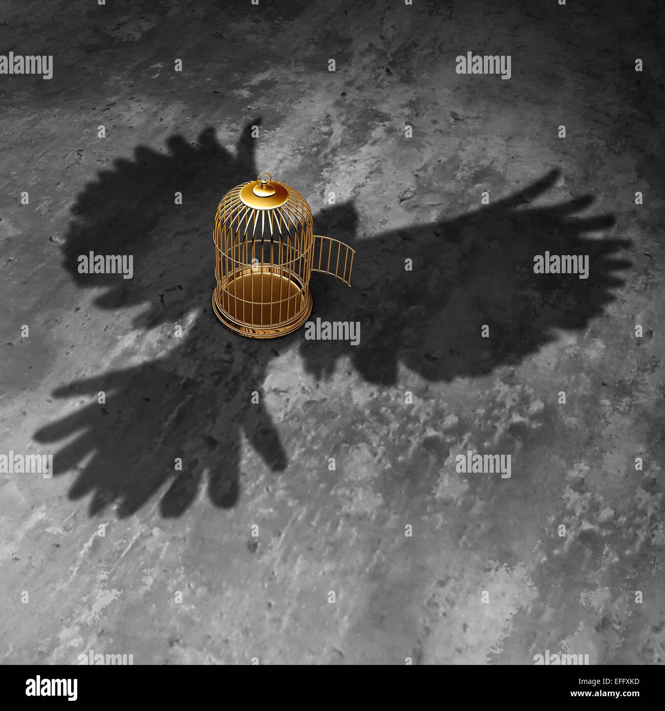 Käfig Freiheit Konzept als eine offene Vogelkäfig mit einem Riesenvogel werfen Schatten fliegen über Stockbild