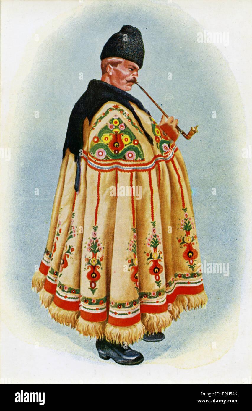 Ungarischer Schäferhund mit Pfeife und verzierte traditionellen Umhang. Stockbild