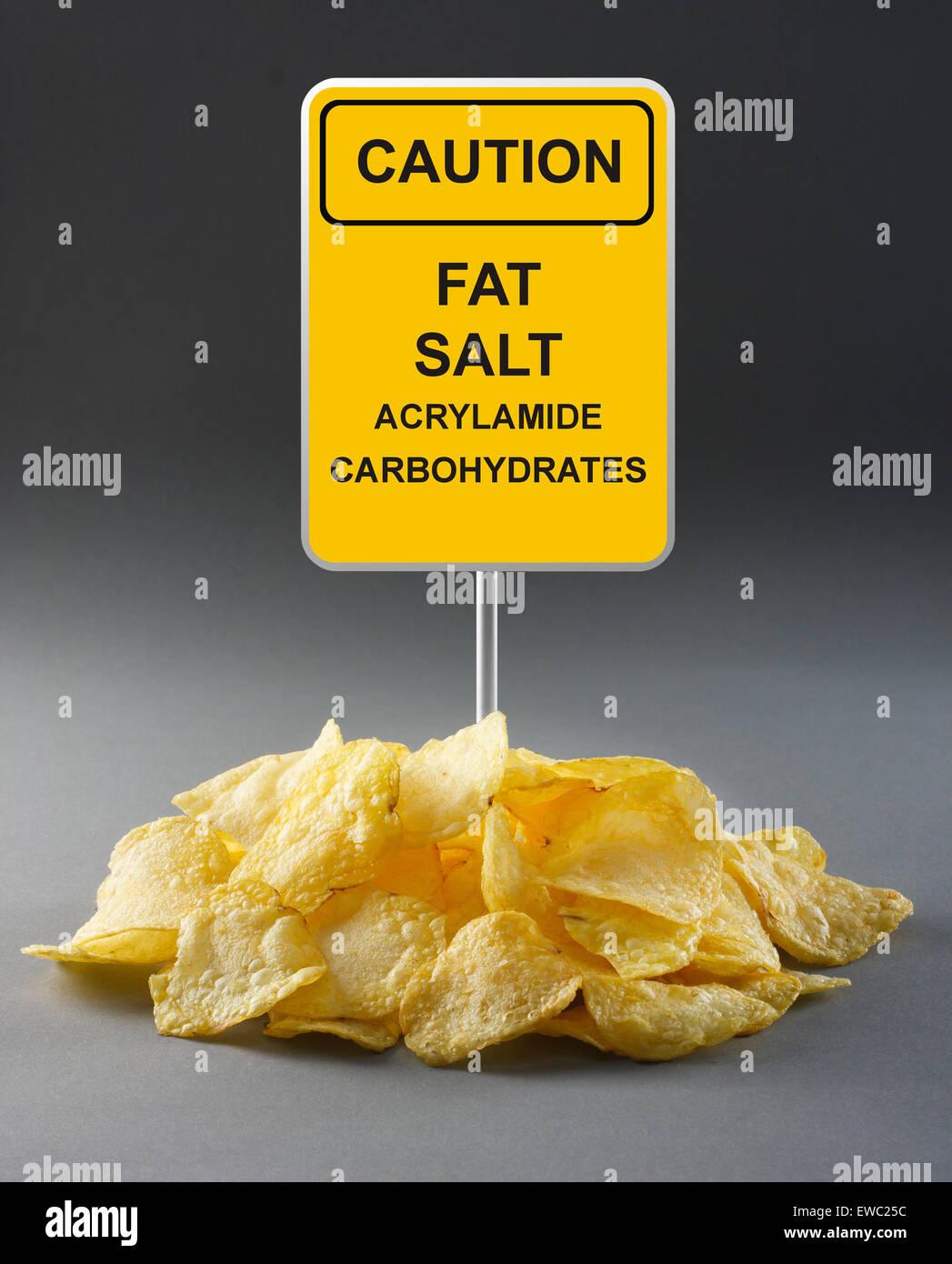 Junk-Food Konzept - Kartoffelchips Stockbild