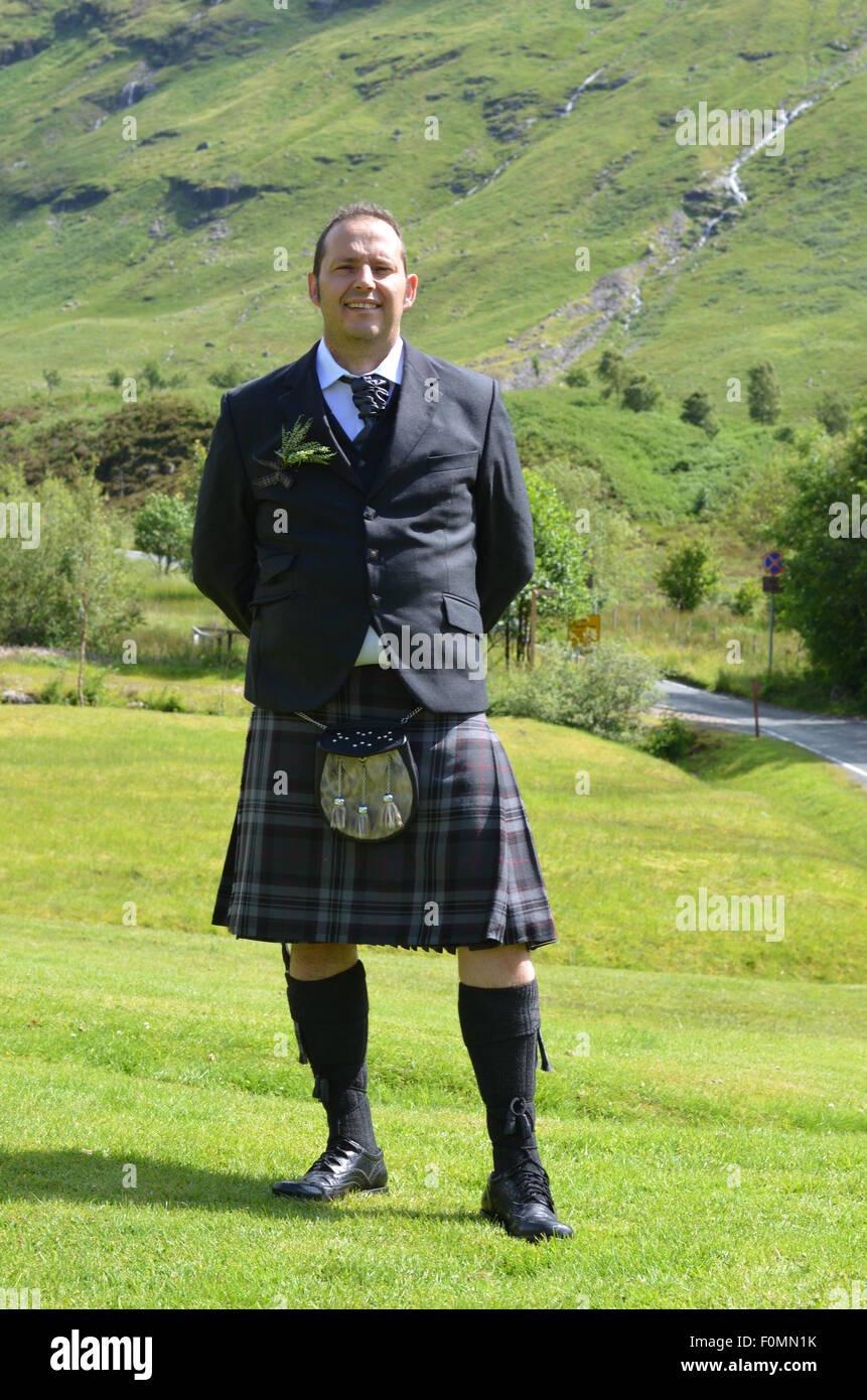 Mann im Kilt in Glencoe Schottland Stockbild