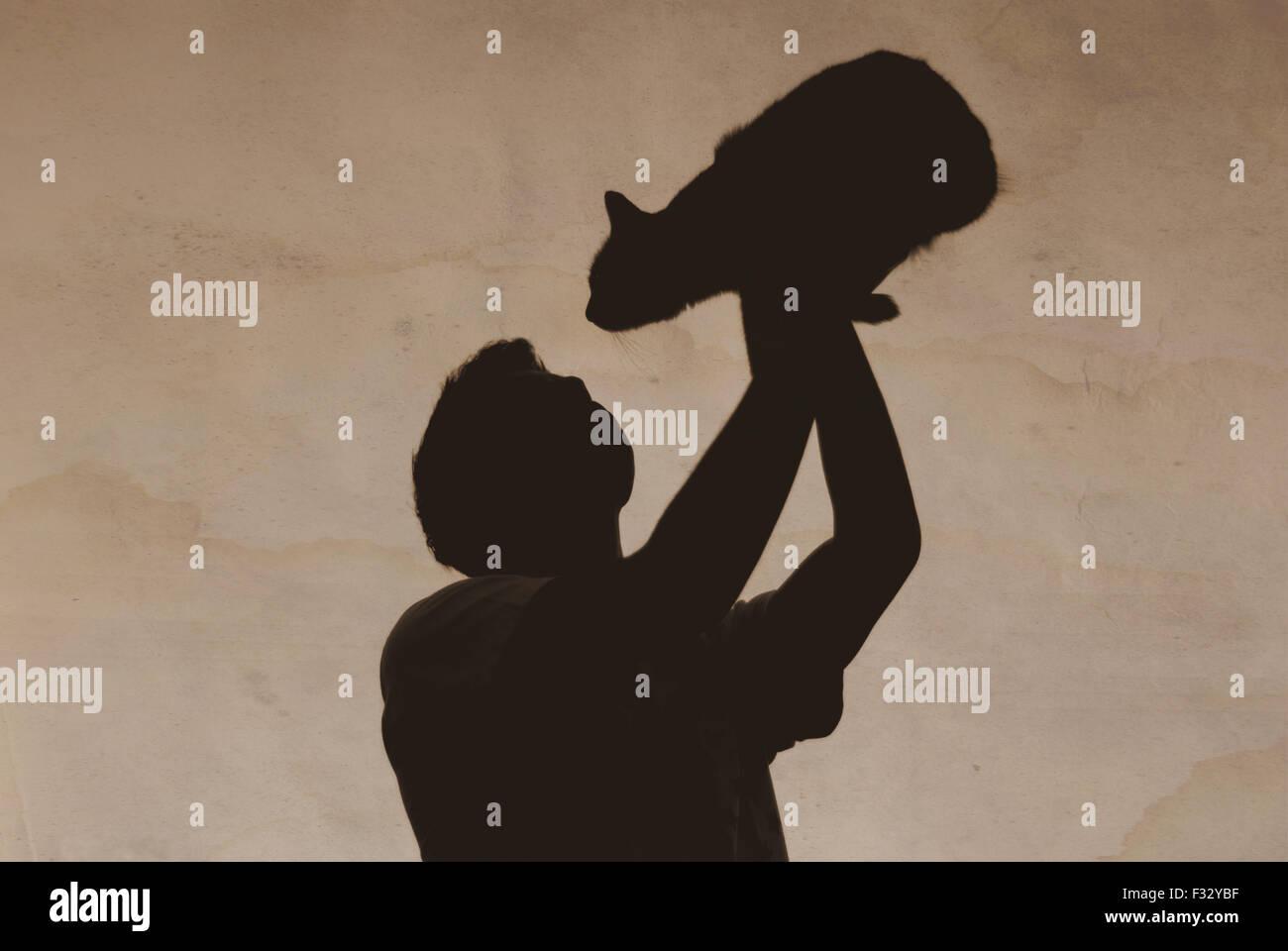 alte Foto junge mit einer Katze Schatten Stockbild