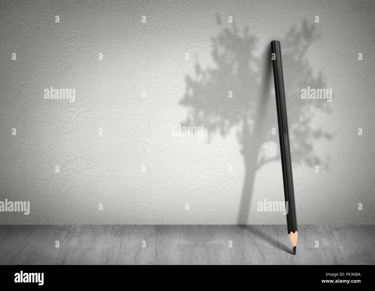 Kreative Ökologie-Konzept, Bleistift mit Schatten eines Baumes mit Textfreiraum Stockbild