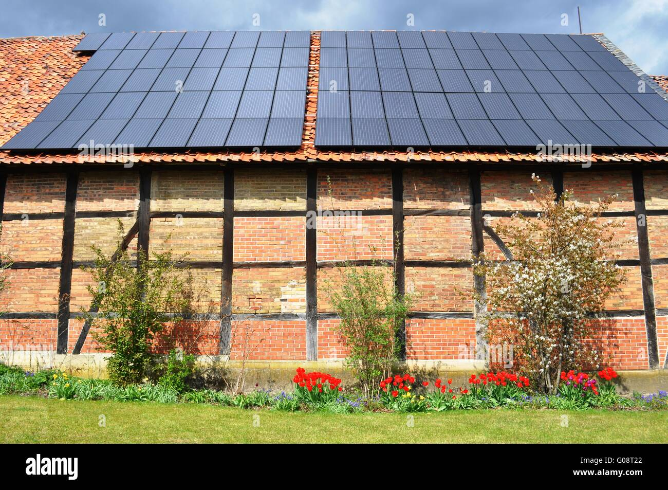 solar panels on roof old stockfotos solar panels on roof. Black Bedroom Furniture Sets. Home Design Ideas