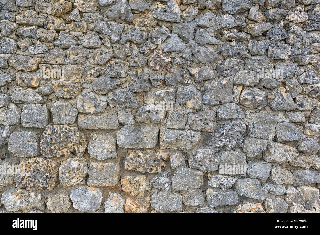 Eine Steinmauer mit Korallen Briks. Sie können als Textur oder Hintergrund Stockbild