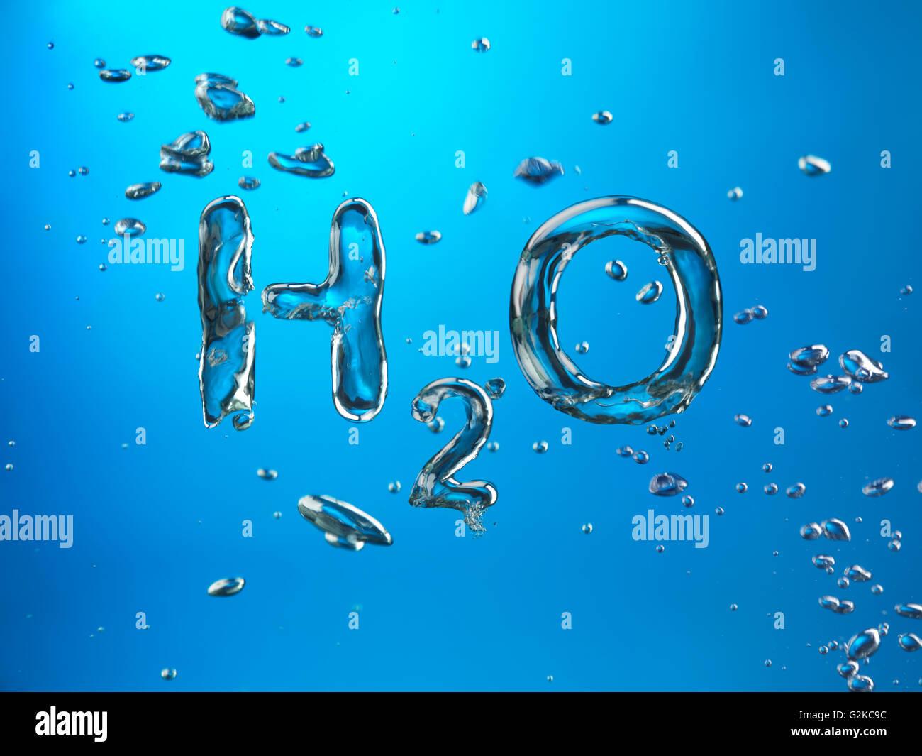 Formel für Wasser, H2O, gemacht von Luftblasen im Wasser Stockbild