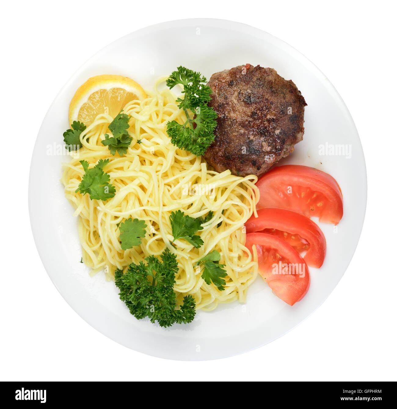 Spaghetti und Fleischbällchen auf Platte isoliert Draufsicht Stockbild