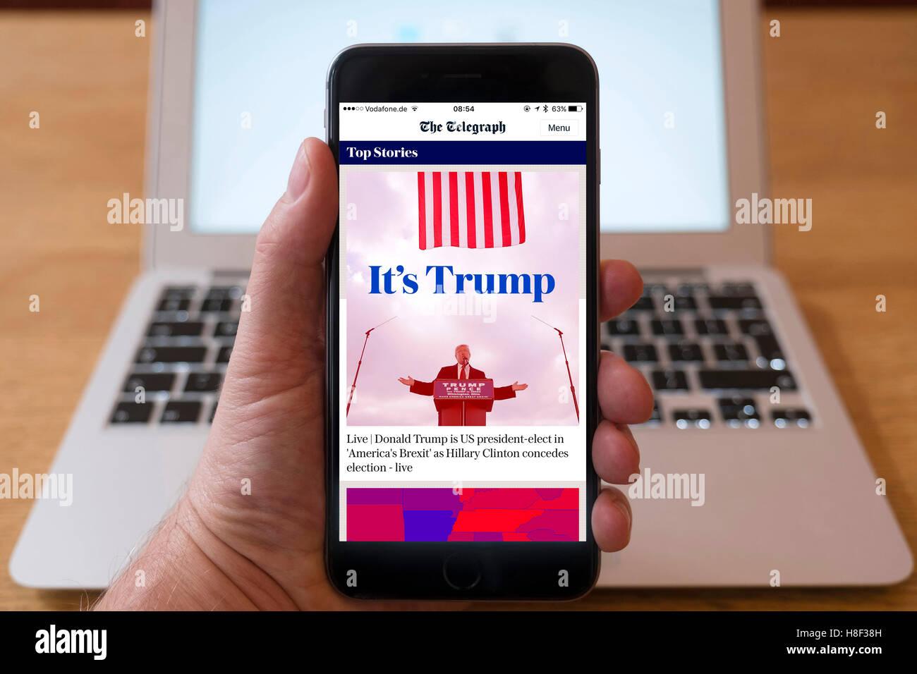 Detail des iPhone Smartphone zeigt Online-mobile Front-Page Schlagzeile vom The Telegraph nach Donald Trump vi Stockbild