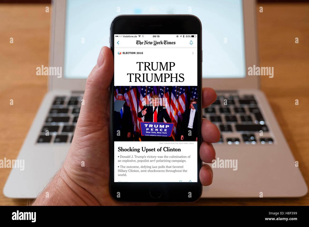 Detail des iPhone Smartphone zeigt Online-mobile Front-Page Schlagzeile aus der New York Times nach Donald Trum Stockbild