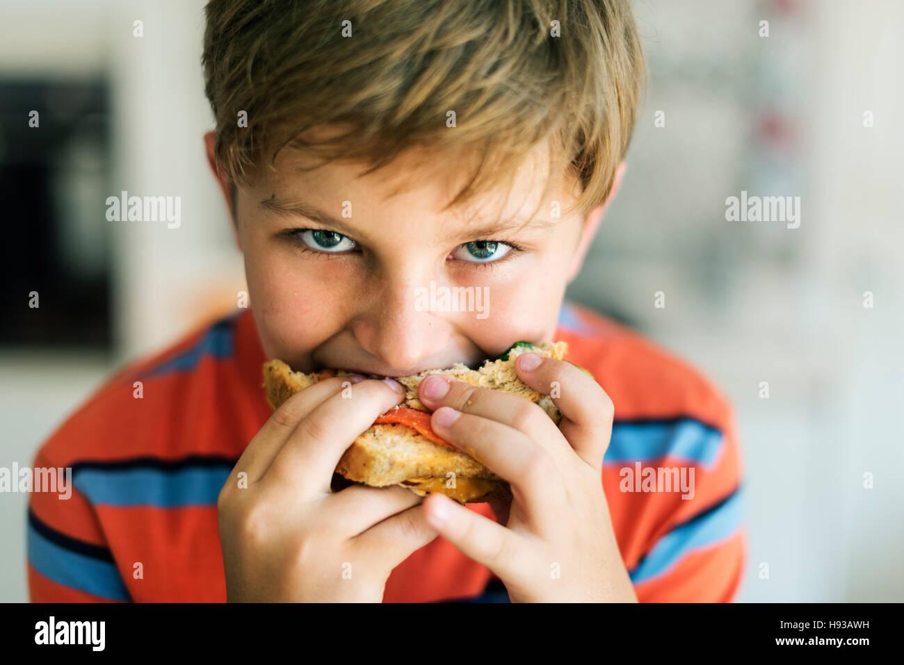 Kind Kinder Hunger Hunger Kid Sandwich-Konzept Stockbild
