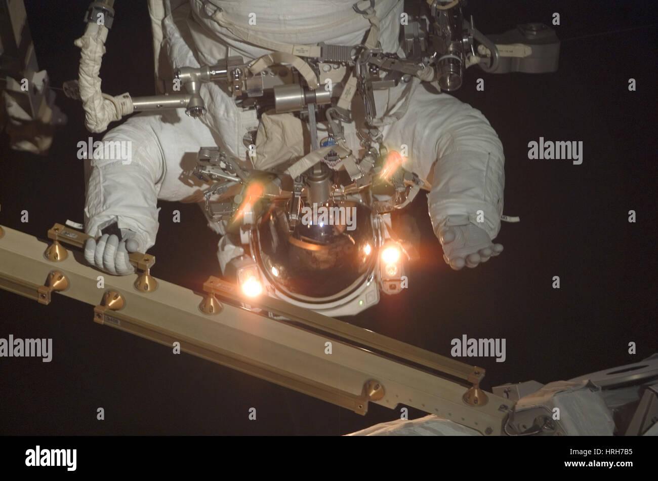 Astronaut Patrick Forrester auf Weltraumspaziergang Stockbild