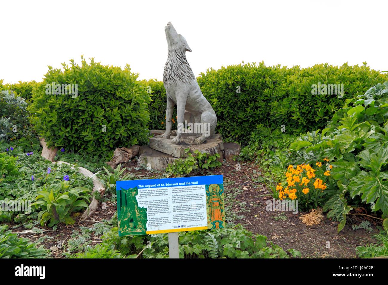 Alten Hunstanton, Denkmal für die legendäre Wolf, die St. Edmund bewachten abgetrennten Kopf. Geschnitzte Stockbild
