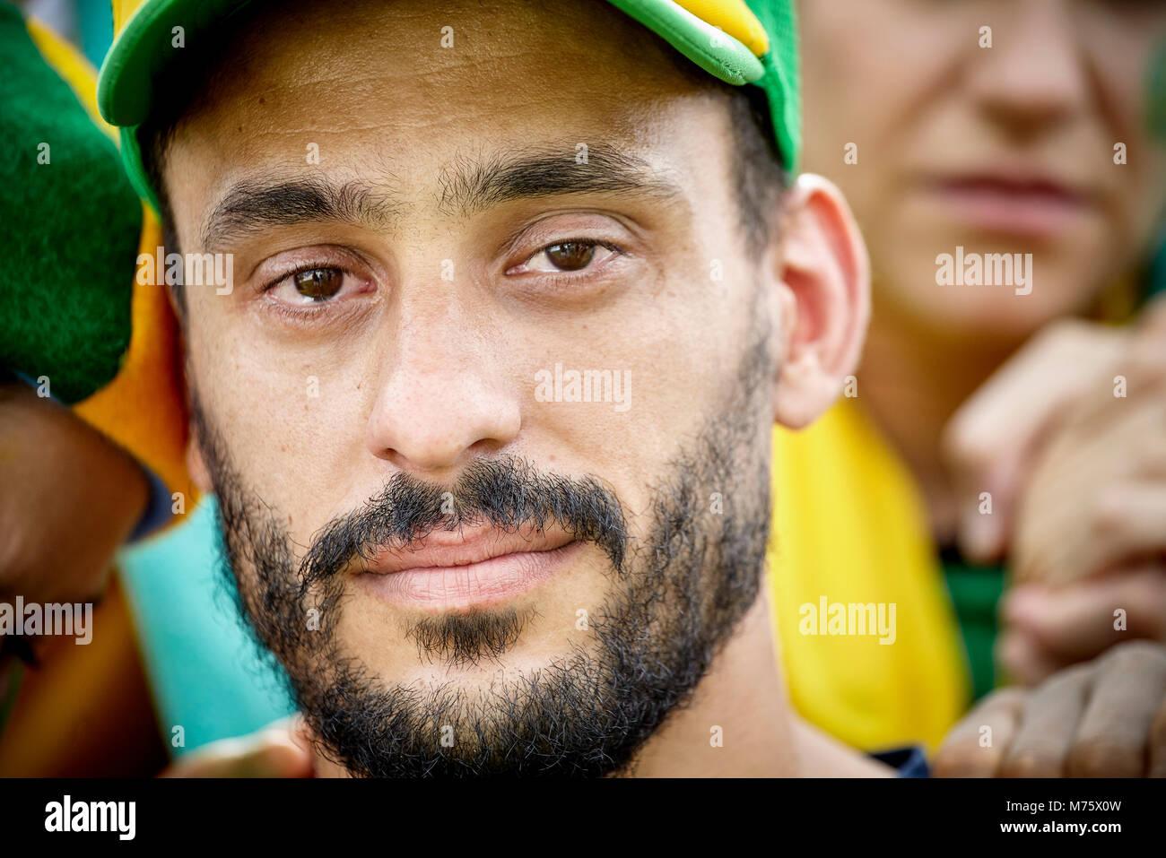 Fußball-Fan mit Tränen in den Augen, Porträt Stockbild