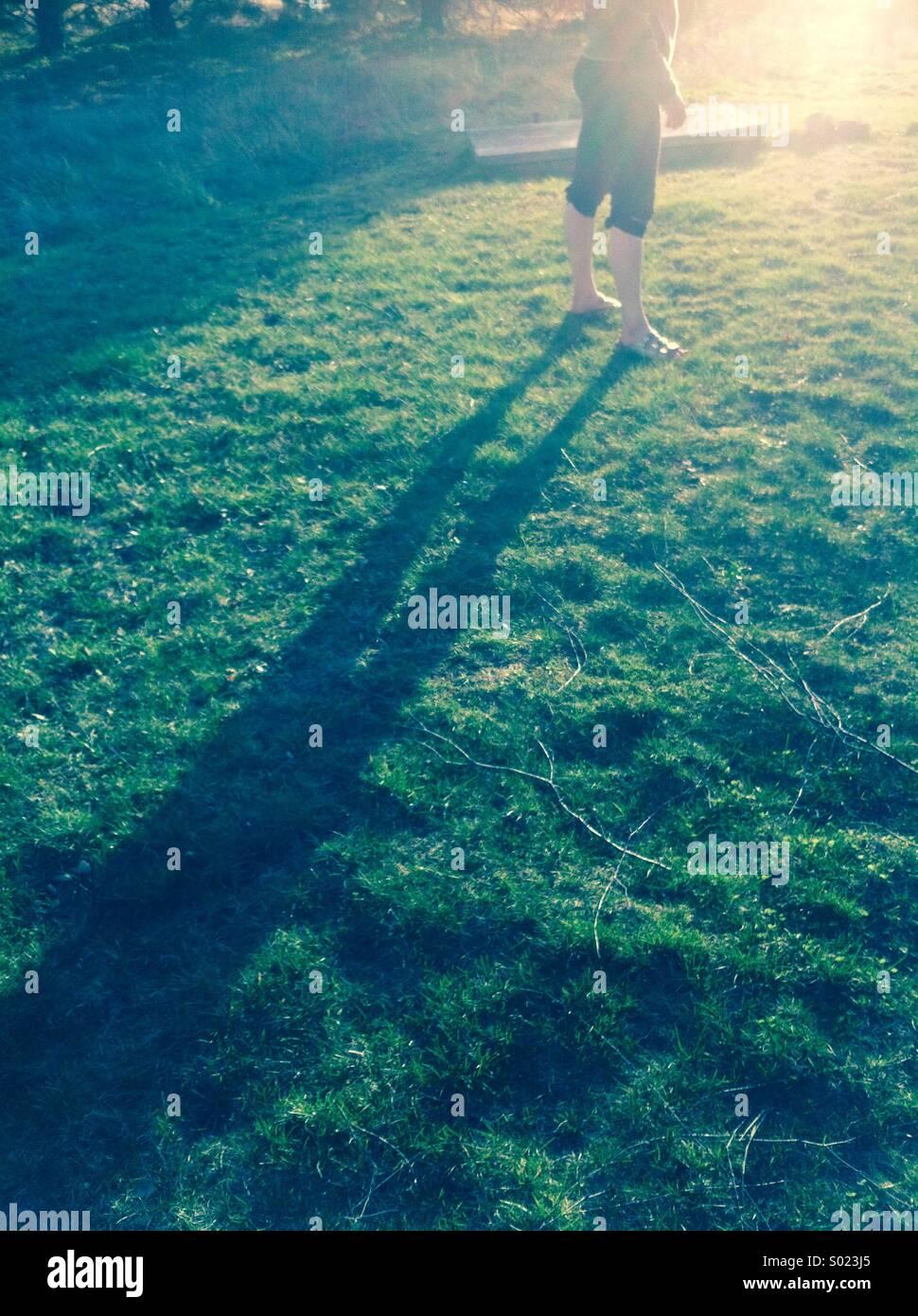 Beine mit Schatten Stockbild