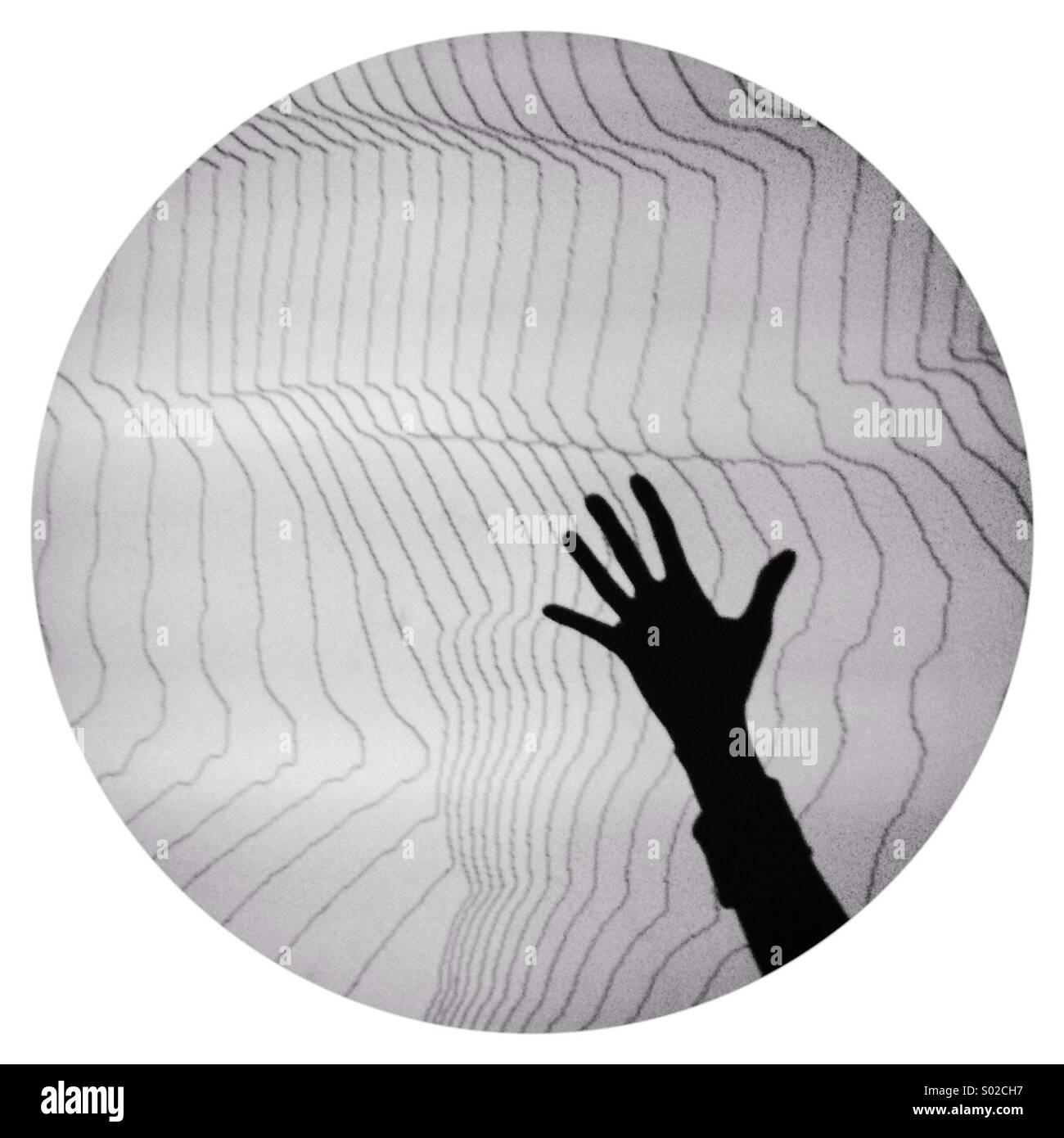 Hand-Schatten im Kreis Stockbild