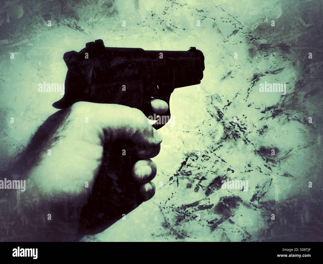 Mann mit einer Pistole schießen Stockbild