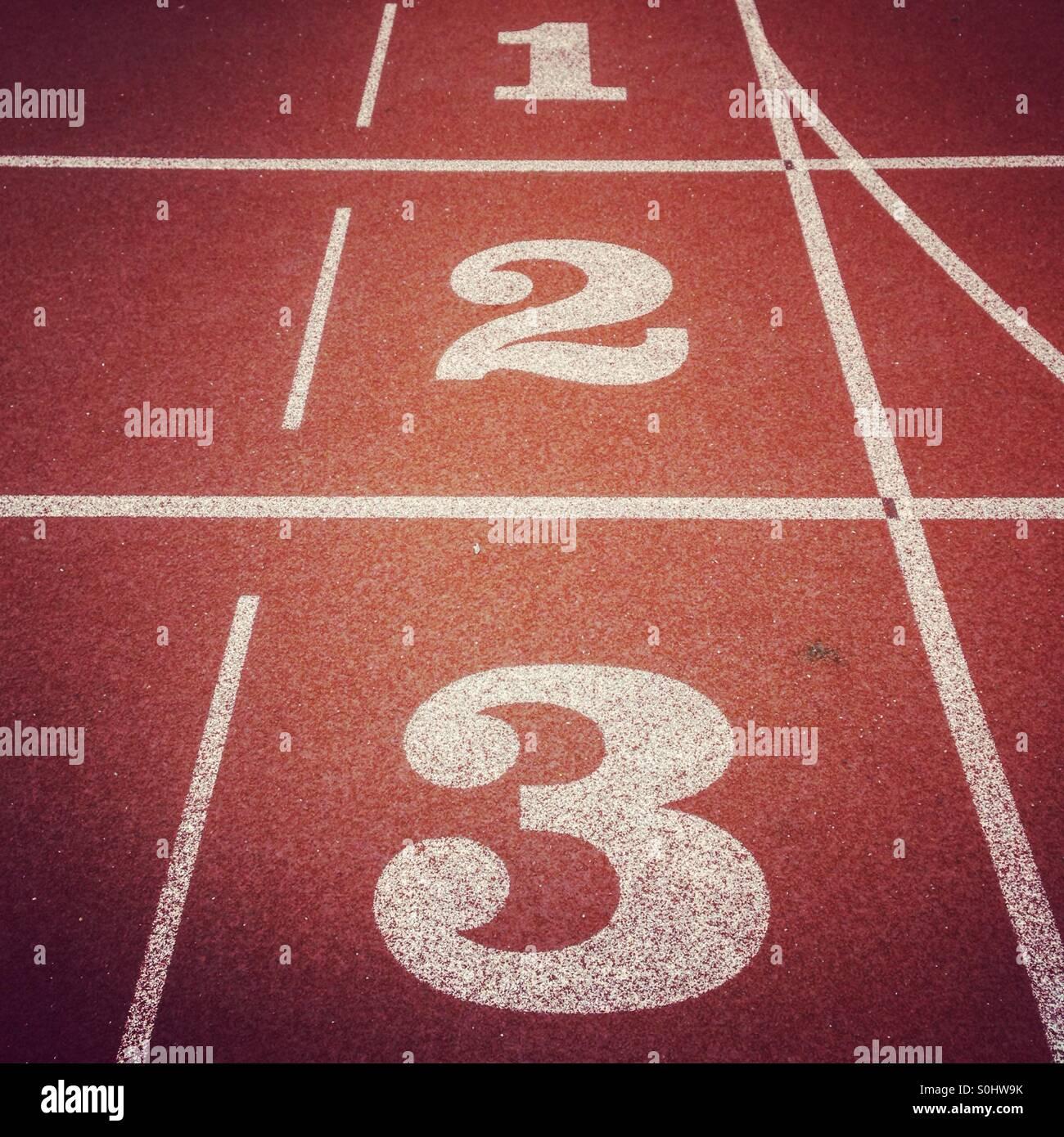 Leichtathletik-Track-Nummern Stockbild