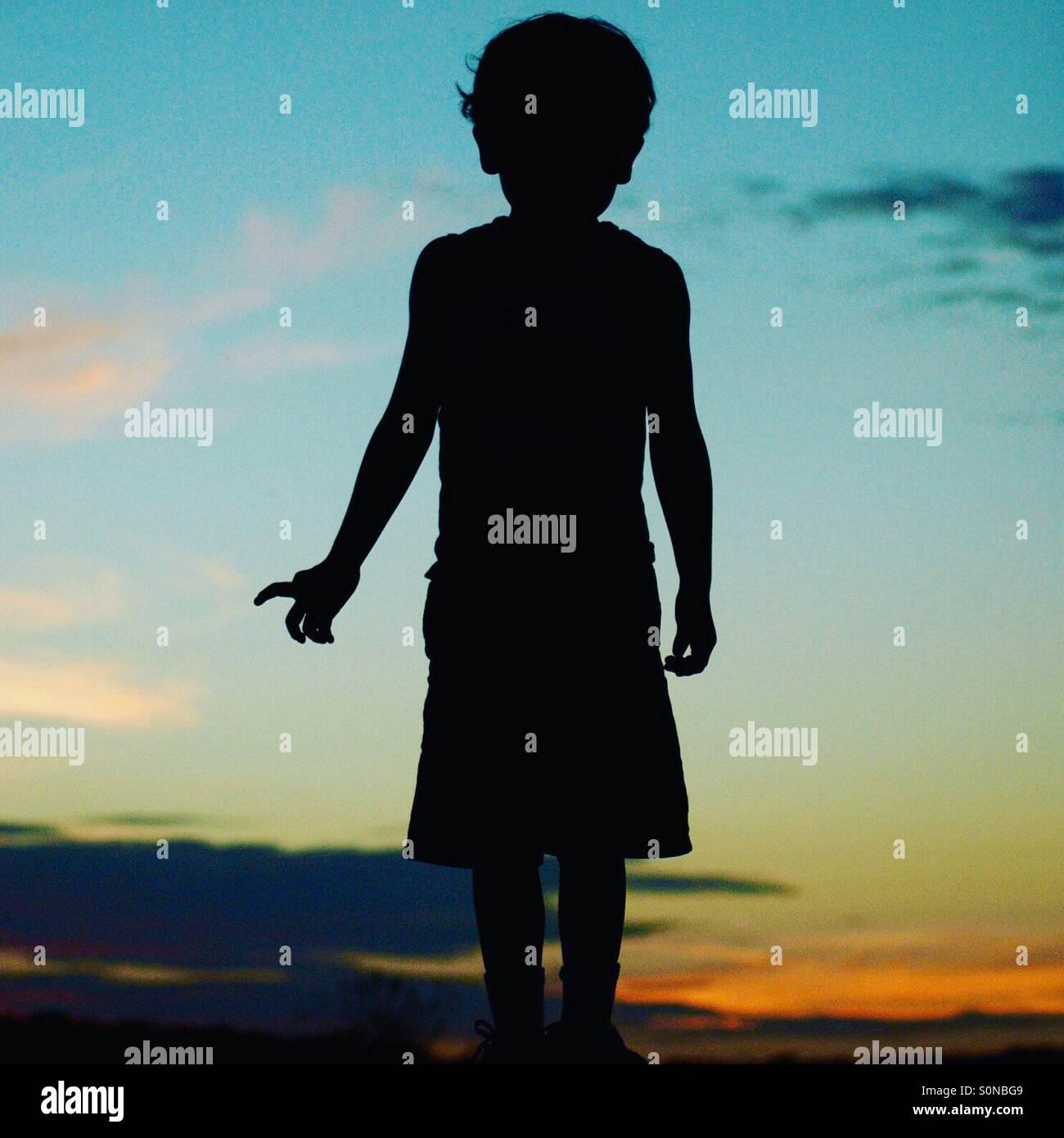 Junge silhouette Stockbild