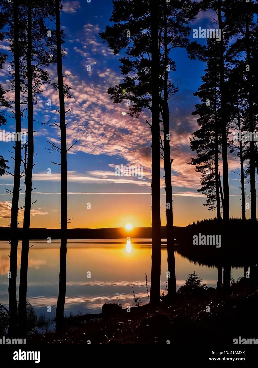 Sonnenuntergang am Kielder Wasser und Wald, Northumberland Park, England Stockfoto